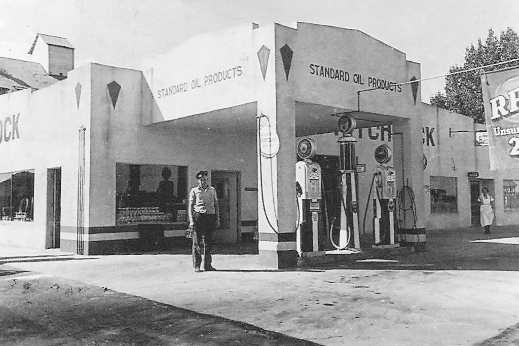 Delbert Taylor stands in front of the old Standard Oil station