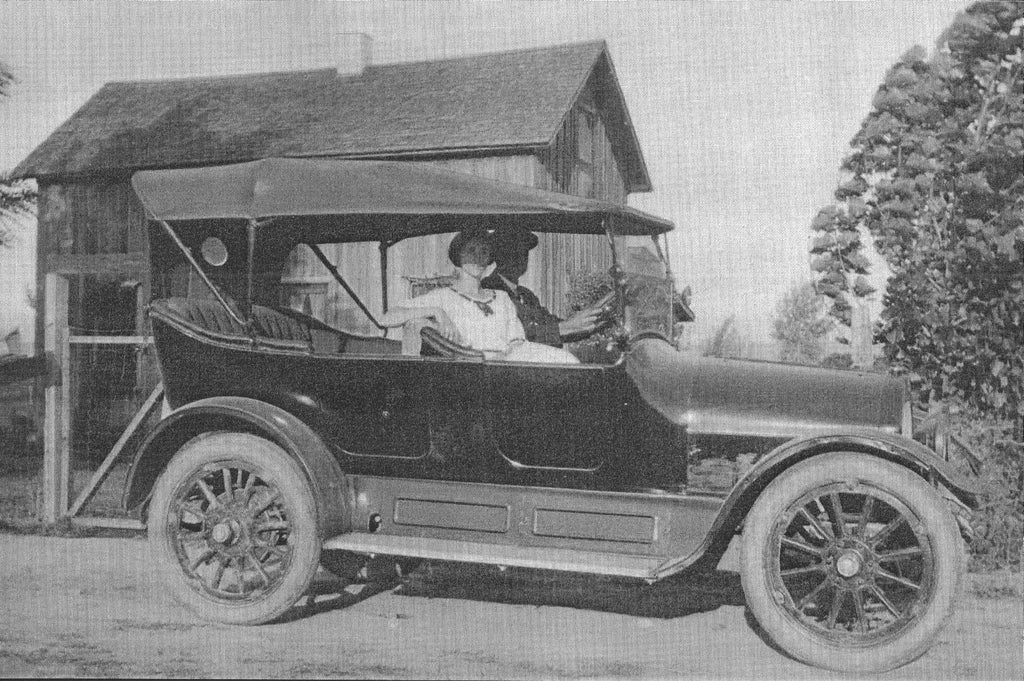 Theo and Mildred Fisher in an Overland car