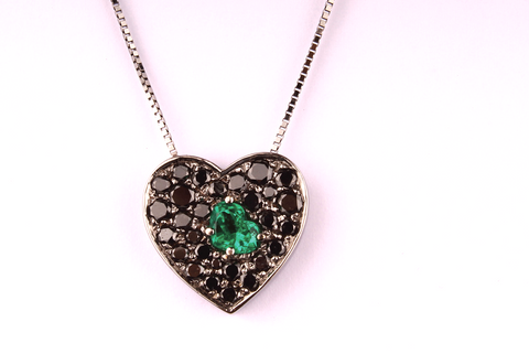 """ An Emerald Heart inside a pavè of Black Diamonds """