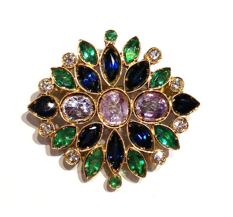 A Rose Window with Sapphires and Emeralds