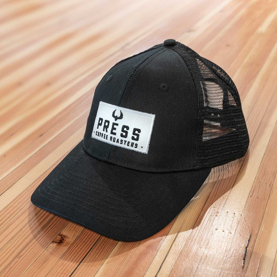 PRESS Patch Snapback Trucker Hat
