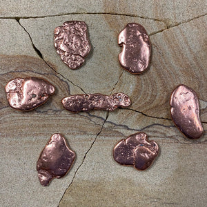 Copper piece.  Flat pieces are approximately 1.5-2 inches.