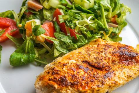 grilled chicken breast served with salad
