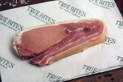 rasher of middle bacon displayed on true bites branded greaseproof paper
