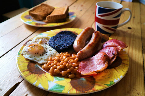bacon, sausage, black pudding, egg and beans on a plate
