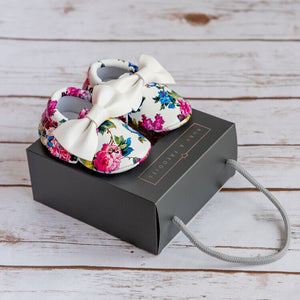 Dark floral moccasins with white bow