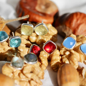 faceted gemstone studs in a variety of semi precious stones