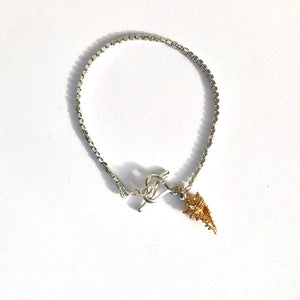 Seed bracelet with a shell charm