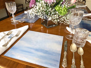 "Blue and white 12"" placemat made of durable tempered glass in the USA by Brooks Works Studio"