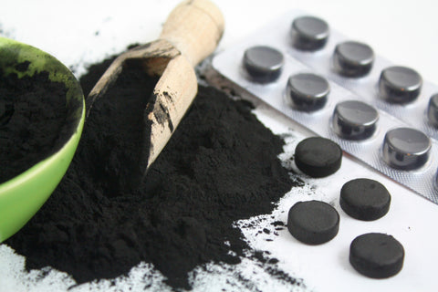 How much activated charcoal to give a dog?