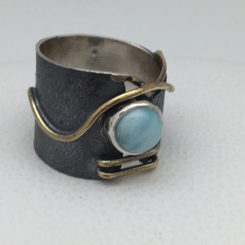Larimar round brass wavy oxidized base.J