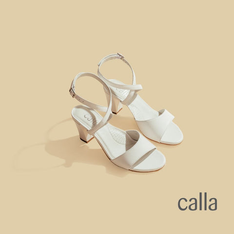 a pair of white calla shoes for bunions