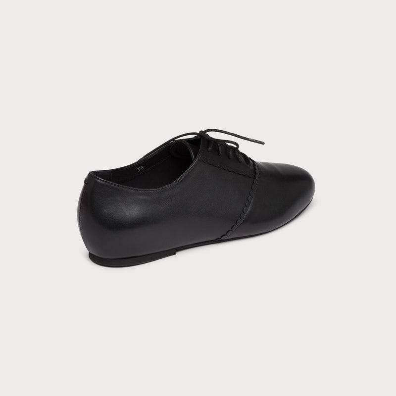 black leather flat brogue back view