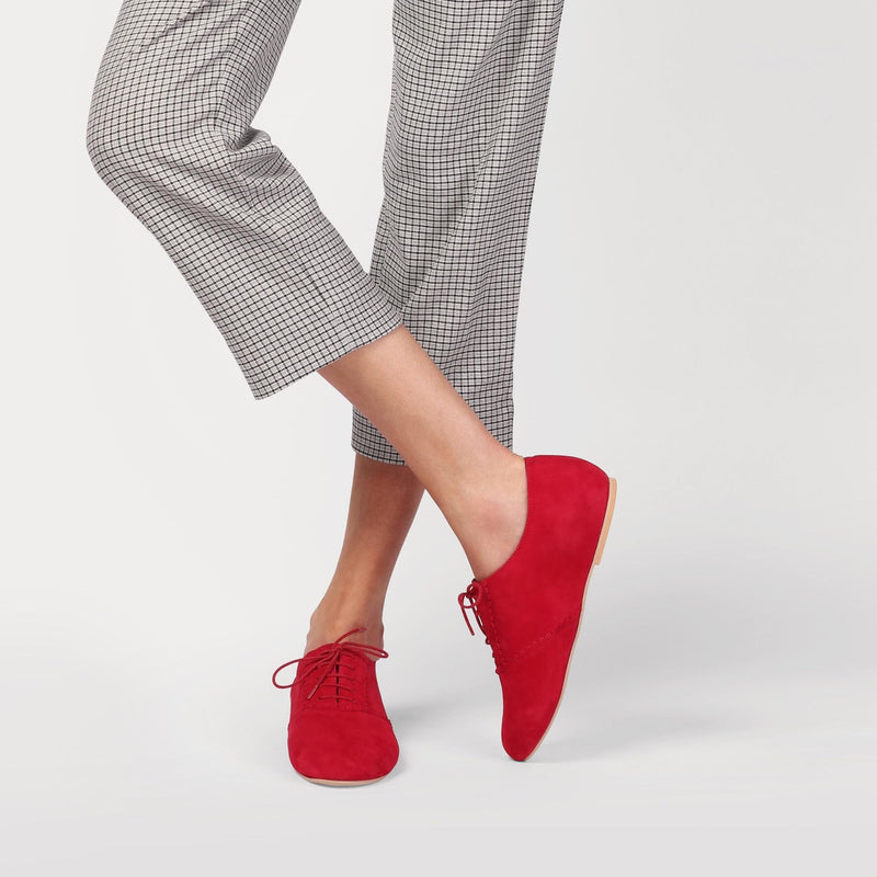 red suede brogue shoes worn with checked trousers