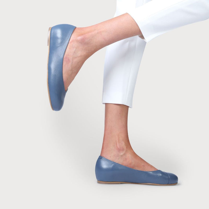 blue leather flats for bunions worn by a model