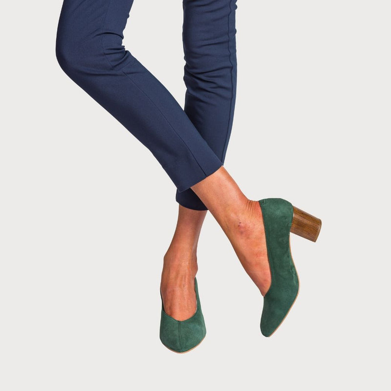 model wearing green suede heels