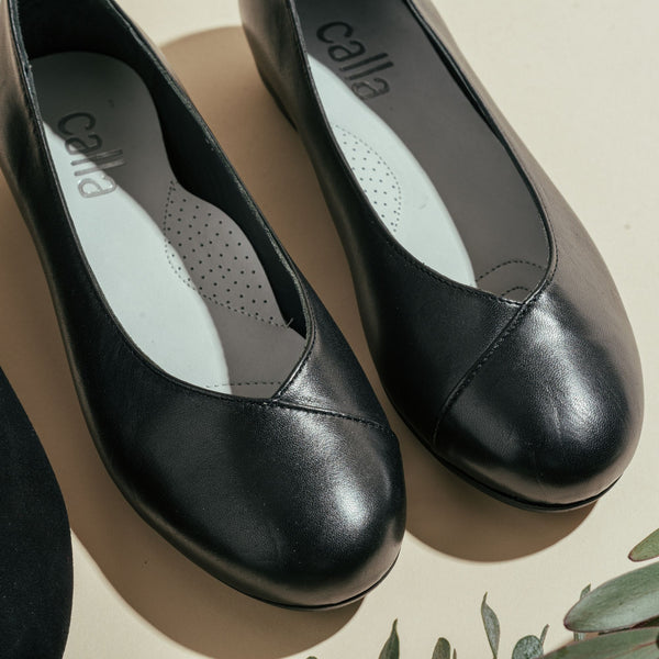 black leather flats for bunions close up