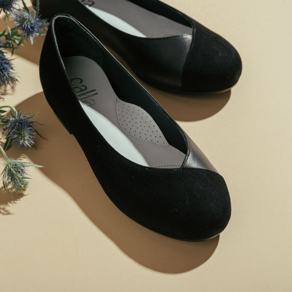 close up black flats for bunions