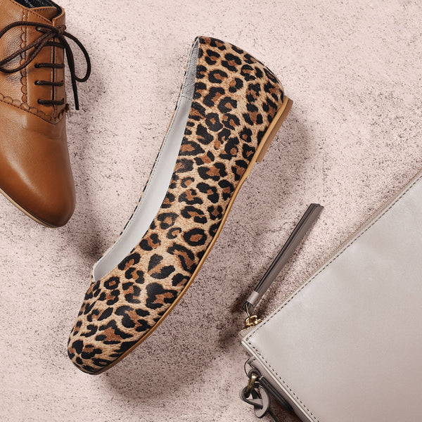 leopard suede flat shoe on concrete background