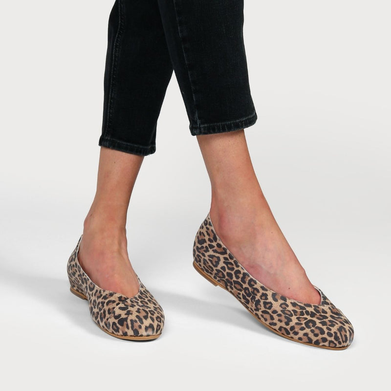 leopard suede shoes on feet