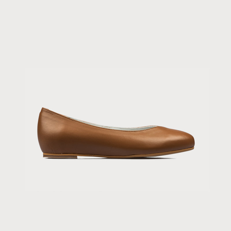 tan leather flat side view