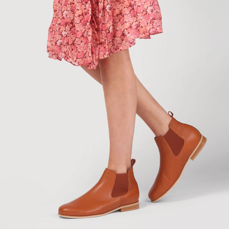 chloe tan boots shown on legs