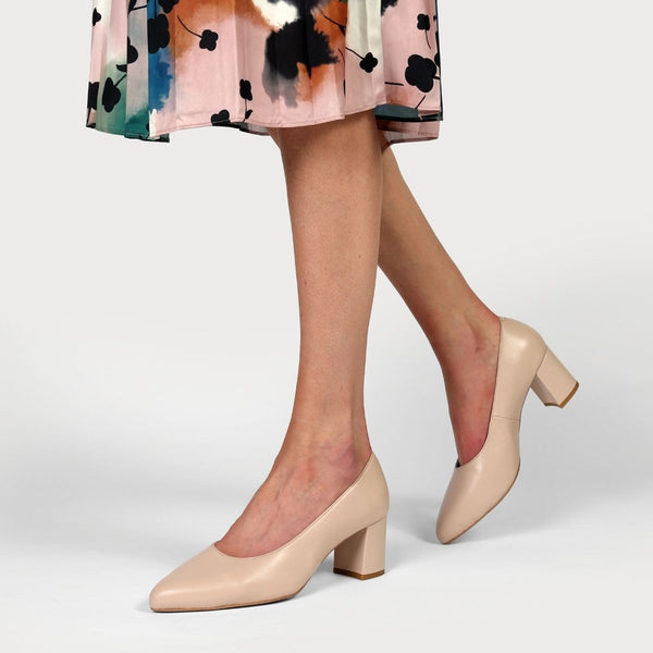 nude leather court shoe worn with a floral skirt