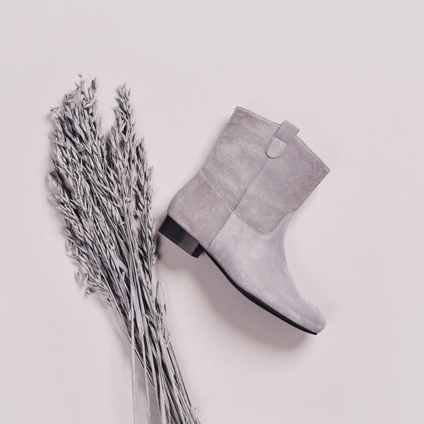 grey suede boots with a silver plant