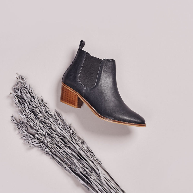 dark grey leather boots on side