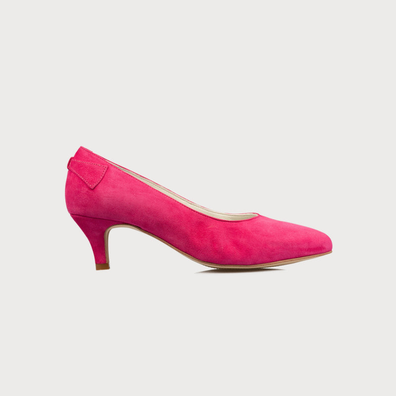 fuchsia suede kitten heel shoes for women with bunions in a wide fit on a grey background side view