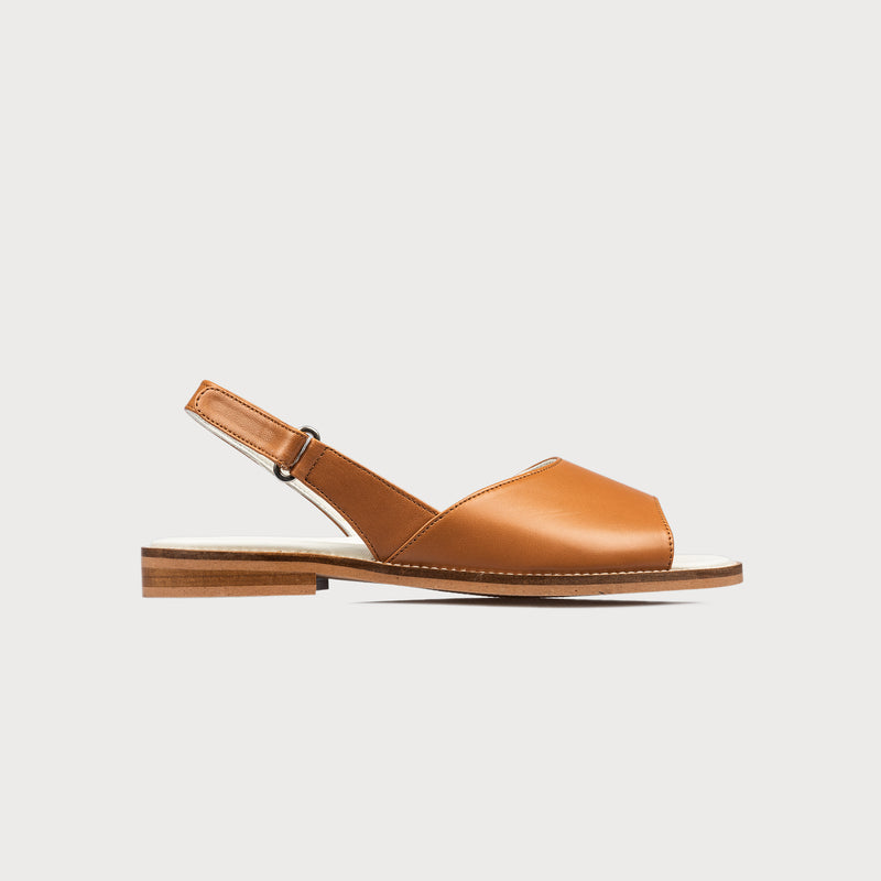 flat tan leather sandal side view