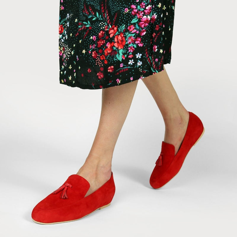 woman walking in red suede loafers