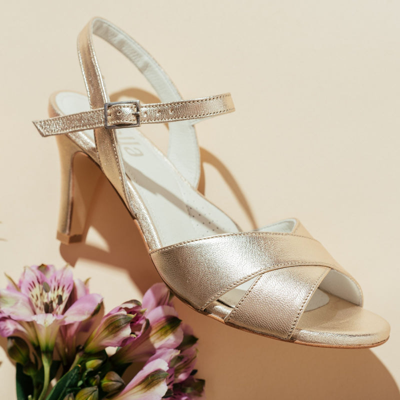 champagne leather mid heel sandals close up