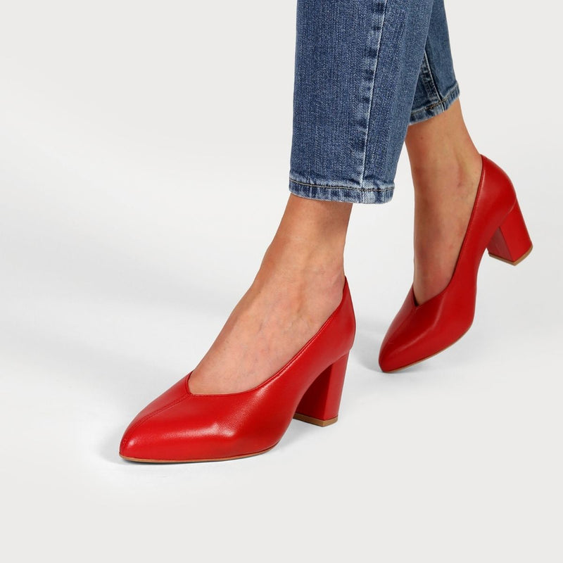 woman walking in red heels and jeans