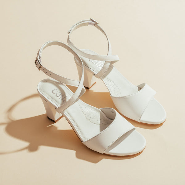 pair of white wedding sandals
