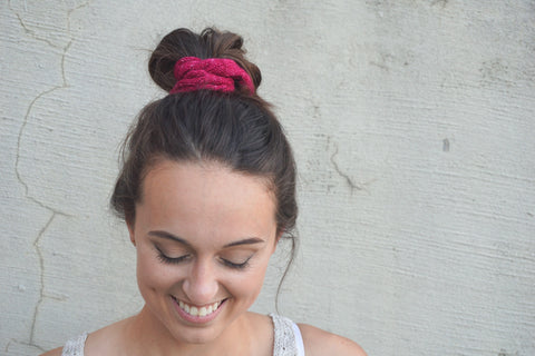 Robyn wearing a pink hand-knit scrunchie