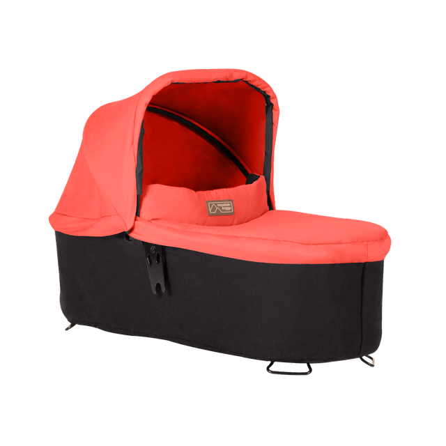 mountain buggy pre-2019 carrycot plus for swift and mini in lie flat mode 3/4 view shown in color coral_coral