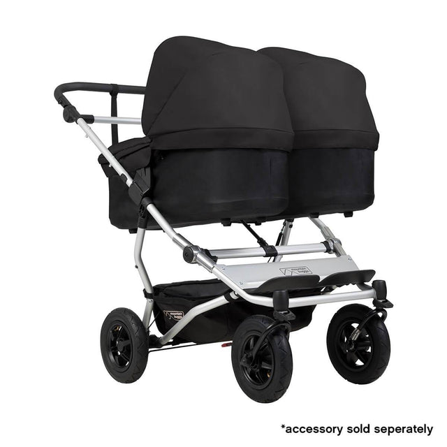 Mountain Buggy duet double buggy fitted with two carrycot plus in parent facing seat position in colour black_black