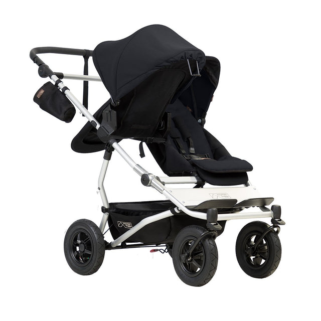 mountain buggy duet double buggy with one 2018 carrycot plus in parent facing mode 3/4 view shown in color black_black