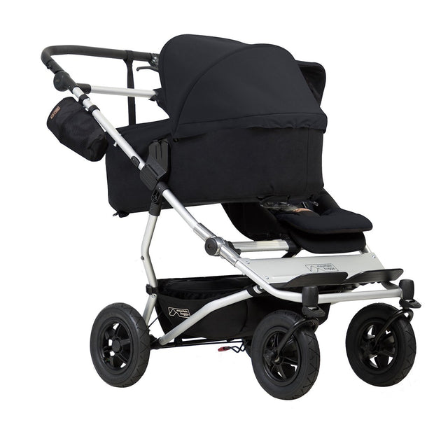 mountain buggy duet double buggy with one 2018 lie flat carrycot plus 3/4 view shown in color black_black