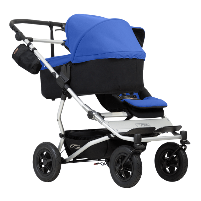 mountain buggy duet double buggy with one 2018 lie flat carrycot plus 3/4 view shown in color marine_marine