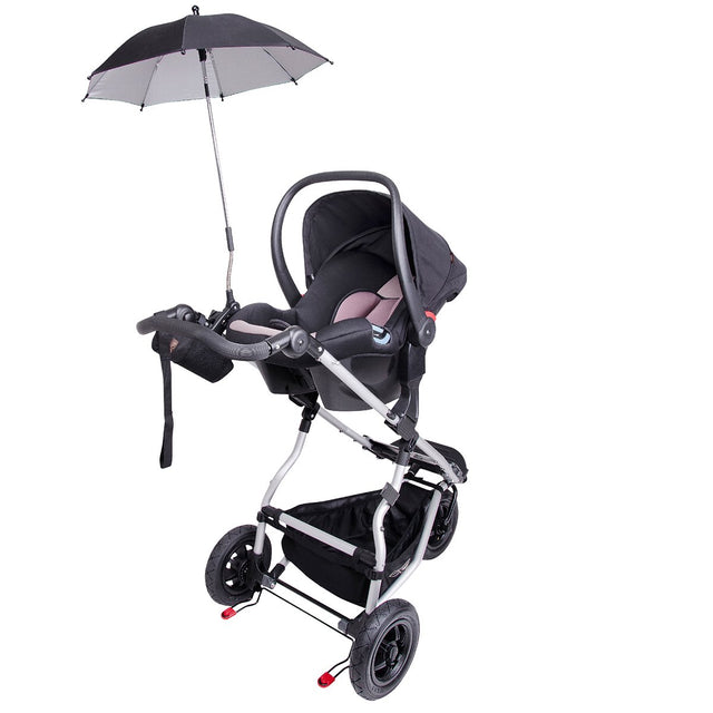 Mountain Buggy parasol umbrella attached to the car seat while on the buggy_black