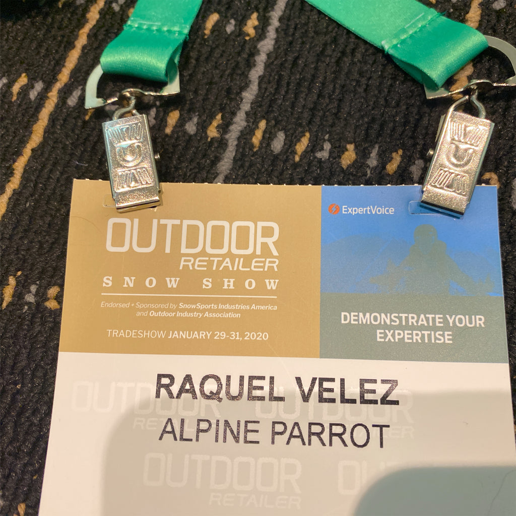 An Outdoor Retailer attendee badge for Alpine Parrot CEO and Founder, Raquel, dated January 2020.