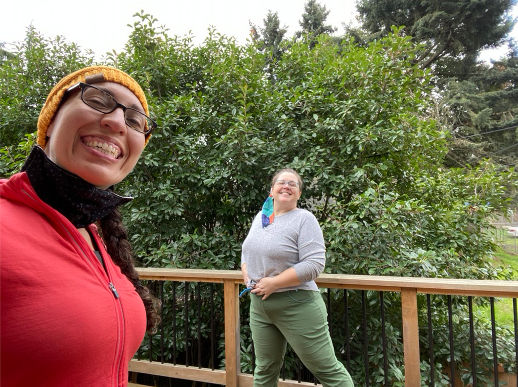 Raquel smiling and taking a selfie with one of the Alpine Parrot fit testers.