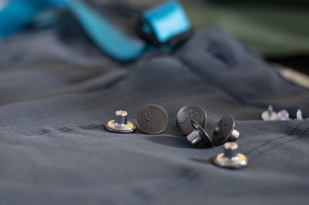 The detailed buttons of the pants.