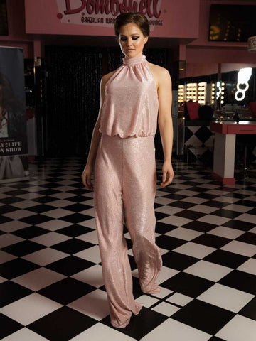 The opening look at the RVA Fashion Week show featured a beautiful pink, sparkle jumpsuit.