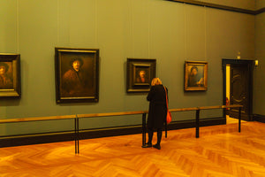 Woman in front of a museum painting