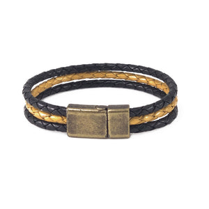 Leather bracelet two black bolo cords and a metallic gold cord and a brass clasp