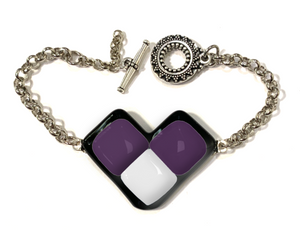 Womens bracelet with purple and white wing shape pendant