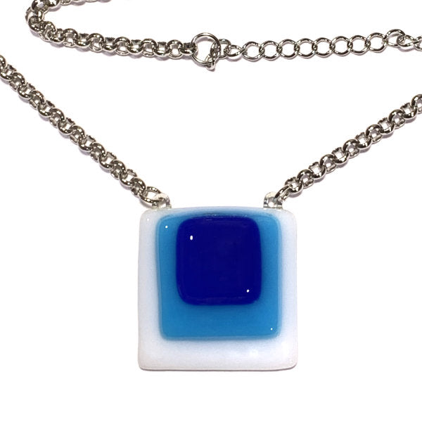 Womens necklace with dark blue, blue and white stained glass squares
